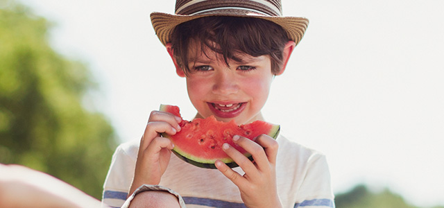 Boy Eating Watermelon Header Mobile