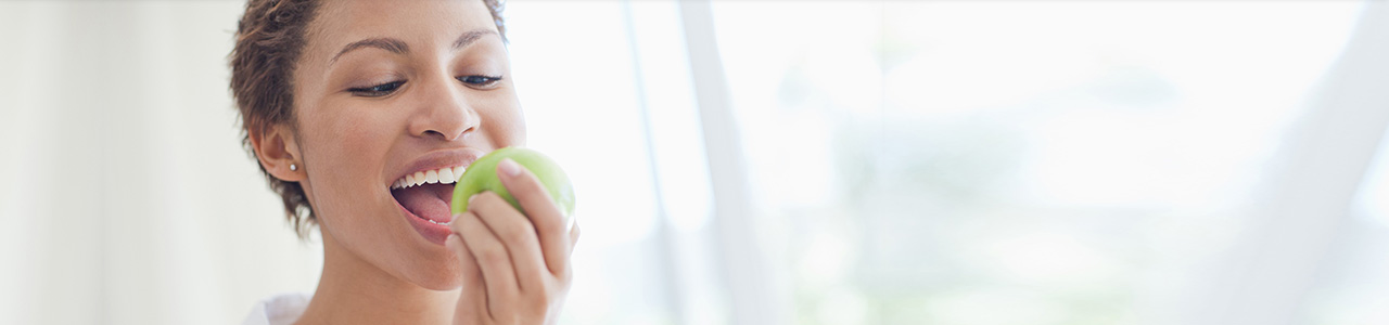 Woman Eating Apple Header