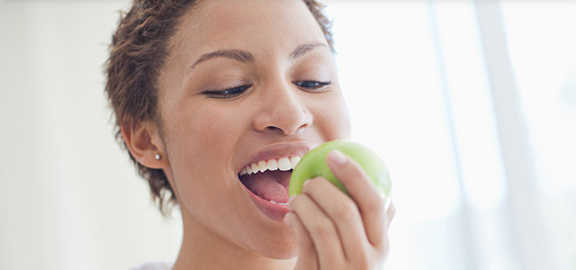 Woman Eating Apple Header Mobile