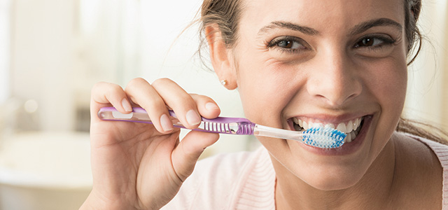 Woman Brushing Teeth Header Mobile