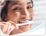 Brushing Teeth with ProNamel Toothpaste Header Mobile